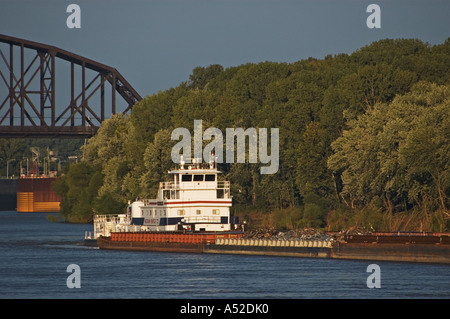 Tug Boat Barge Carrying Scrap Metal Exiting McAlpine Locks Dam On Ohio River Louisville Kentucky - Stock Photo