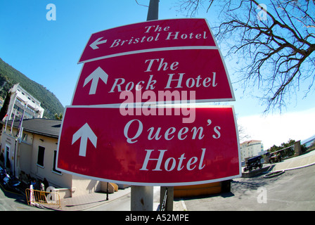 main street city of gibraltar the rock wideangle fisheye lens sign red queens hotel the rock hotel famous - Stock Photo