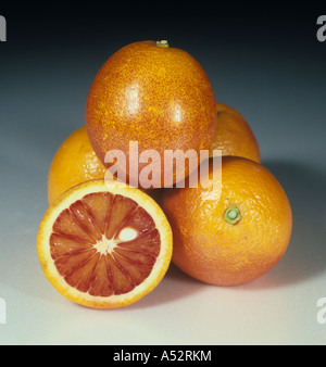 Whole sectioned blood orange fruit variety Sanguinelli - Stock Photo