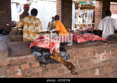 A leg of beef on the butchers stall at the Saturday market in the village of Nkhoma Malawi Africa - Stock Photo