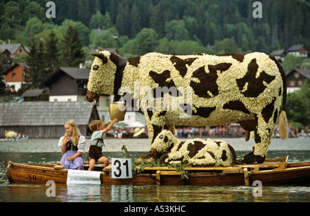 Cow sculpture on a boat traditional daffodil festival on the Grundl lake Styria Austria - Stock Photo