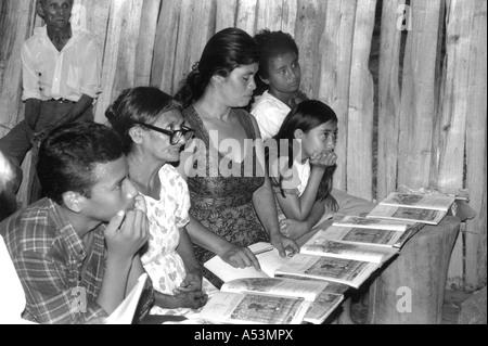 Painet ha1449 274 black and white adult literacy class organised by cntc rural community san pedro sula honduras - Stock Photo