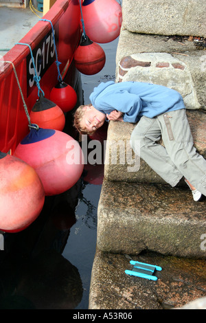 Boy crabbing on holiday - Stock Photo