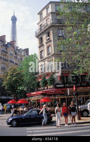 Le Champ De Mars Restaurant on Ave de la Bourdonnais in Paris with Eiffel Tower - Stock Photo
