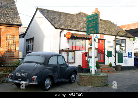 A typical British post office with a Morris Minor 1000 parked outside. - Stock Photo