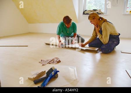 People women woman lay laying laminate Nuremberg Bavaria Germany - Stock Photo