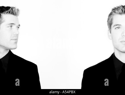 Business man is looking at himself in black and white - Stock Photo