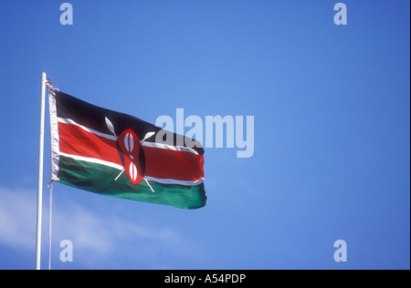 The National flag of Kenya East Africa flying on a white flagpole against a blue sky - Stock Photo