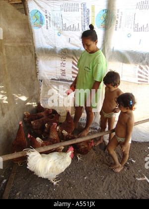 Painet ip2347 nicaragua mother children feeding chickens posoltega country developing nation less economically developed - Stock Photo
