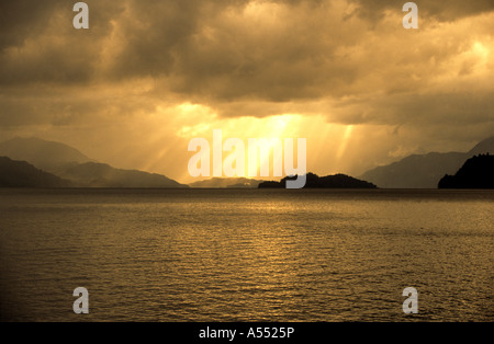 Sunbeams through storm clouds over Lake Todos los Santos, Vicente Perez Rosales National Park, Chile - Stock Photo