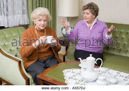 Senior woman getting frustrated at friend - Stock Photo
