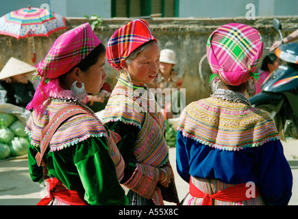 Hmong girls chat at the market in BacHa Northern Vietnam - Stock Photo