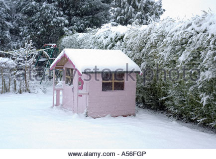 Pink Wendy House in the Snow - Stock Photo