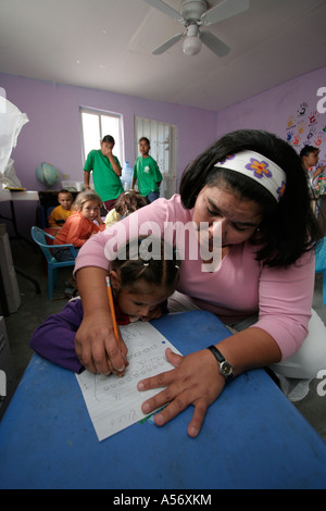Painet ja1070 girl mexico hispanic private school day care center bibioteca infantil buen pastor anapra juarez chihuahua - Stock Photo