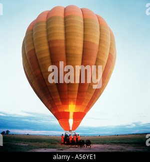 Filling a balloon with hot air at dawn, Masai Mara ( Maasai Mara ), Kenya - Stock Photo