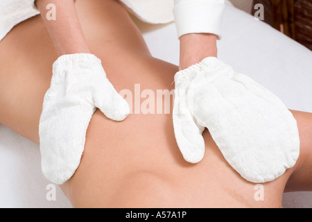 Young woman receiving massage, mid section - Stock Photo
