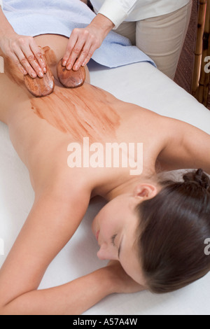 Young woman receiving ayurvedic treatment, elevated view - Stock Photo