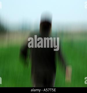 Blurry shot of a man running away - Stock Photo