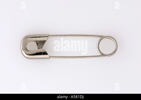 Safety pin, fixing pin - Stock Photo