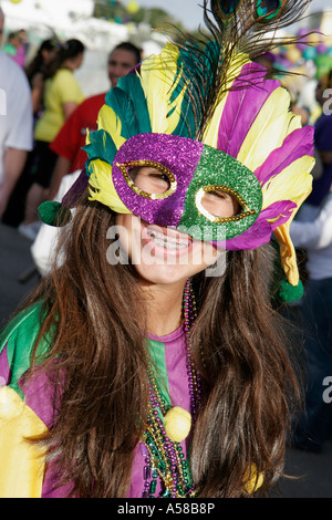 Miami Beach Florida Flamingo Park Mardi Gras Parade Hispanic female teen mask costume braces - Stock Photo