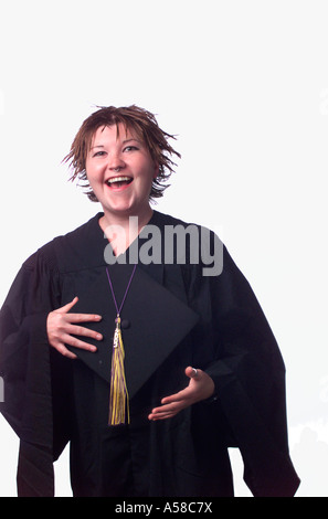 Portrait of a recent graduate in cap and gown - Stock Photo