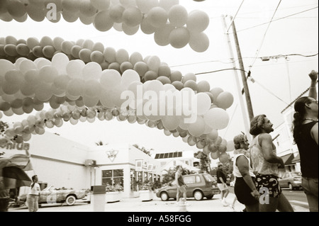 Tinted black and white landscape image of gay pride march in key west Florida. - Stock Photo