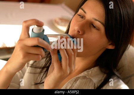 young woman with asthma inhaler - Stock Photo