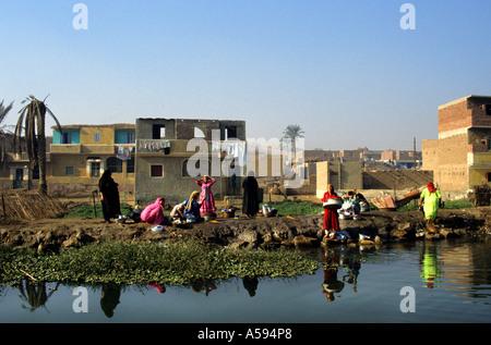 Fayoum Egypt  village woman women wash up washing - Stock Photo
