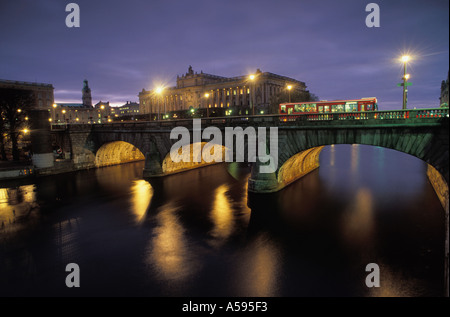 North Bridge over Norrström in central Stockholm connecting Lake Mälaren with the Baltic Sea at night - Stock Photo