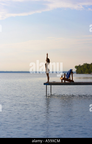 Woman Diving off of Dock - Stock Photo