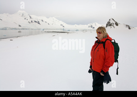 Adventure Tourist on Half Moon Island off the Antarctic Peninsula in Antarctica - Stock Photo