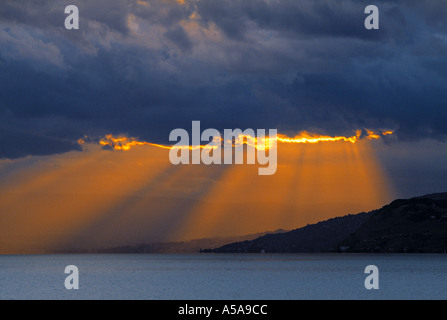 Sun rays through clouds - Stock Photo