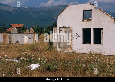 A destroyed Serbian village in Kosovo - Stock Photo