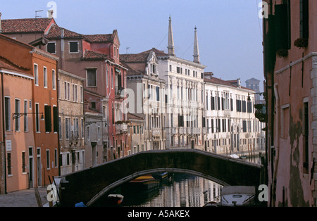 A view of a bridge over a canal in Venice Italy - Stock Photo