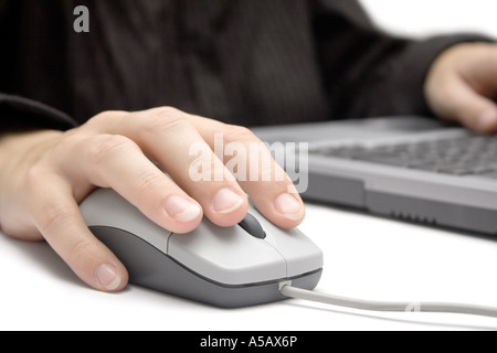 Businesswoman working on a laptop. White background. - Stock Photo