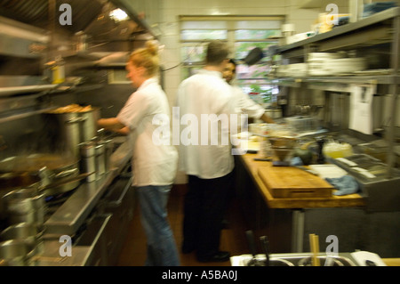 Restaurant Kitchen Staff restaurant kitchen staff busy at work at the stove stock photo