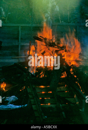 night time bonfire in garden polluting the air and atmosphere - Stock Photo