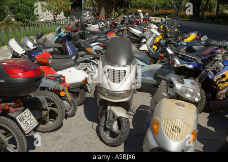 Many motorcycles parked in city street Cadiz Spain - Stock Photo