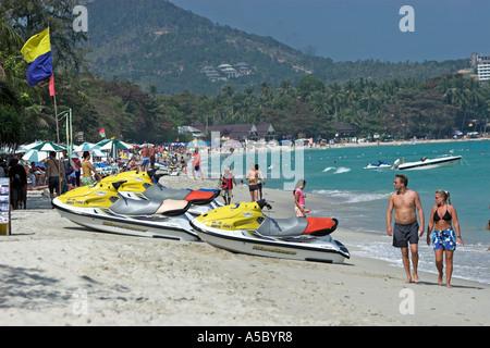 WaveRunner jet skis on busy Chaweng Beach high season Ko Samui island Thailand - Stock Photo