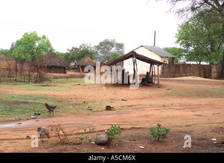 Sheltering from Rain, Village of Mukuni, Zambia - Stock Photo