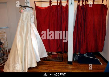 Wedding dresses in a charity shop window Stock Photo: 40017857 - Alamy