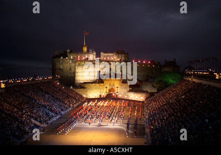 military mass brass band playing at finale of edinburgh military tattoo in front of edinburgh castle - Stock Photo