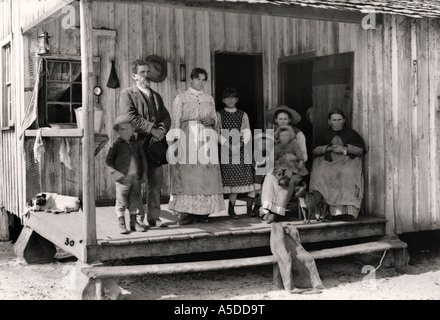 Historic photograph rural family on porch of home in Florida - Stock Photo