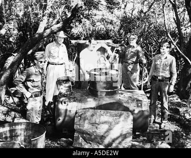 Historic photograph of Florida sheriff with seized moonshine still - Stock Photo
