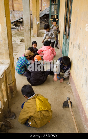 Children play at a school in the village of Ban Ho near the area of Sapa Vietnam - Stock Photo