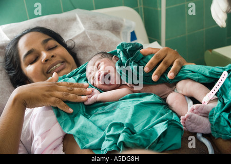 Mother is holding her new born baby in San Fernando Maternity Hospital in San  Fernando, Trinidad, The Caribbean - Stock Photo