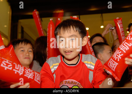 Yong Chinese kids taking part at the 'Year of the Pig' Chinese Lunar New Year celebrations in Hong Kong, China. - Stock Photo