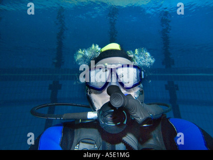 1 one male scuba diver exercises exercise in indoor swimming pool accessory - Stock Photo