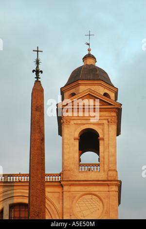 Trinità dei Monti (Santissima Trinità al Monte Pincio or Holy Trinity on Pincio Hill) overlooking the Spanish Steps - Stock Photo