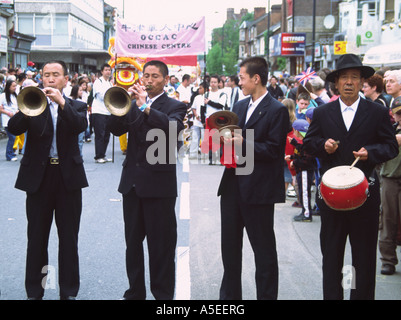 Oxford, UK- 12 June 2005: Chinese musicians playing trumpets, cymbals and drums in the parade on 12 June at Cowley - Stock Photo